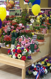 Floral merchandising fixtures, deli counters, Euro slant tables